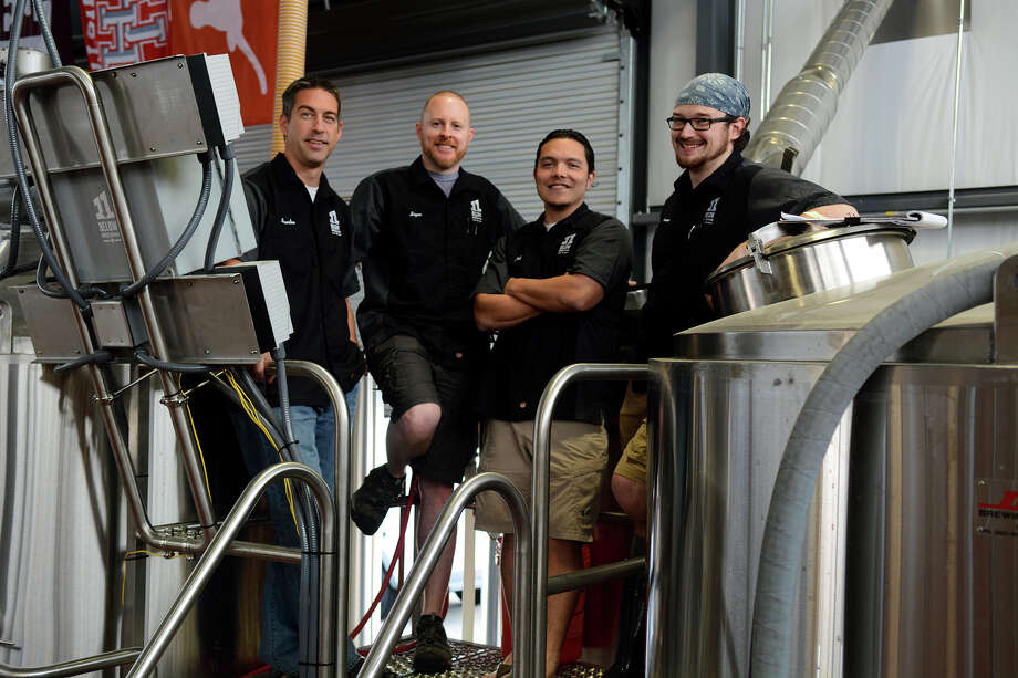 The 11 Below Brewing Co. co-founders Brandon Moss, from left, Bryce Baker and Jeff Handojo and head brewer Keenan Zarling are on the job. Photo: Jerry Baker, Freelance