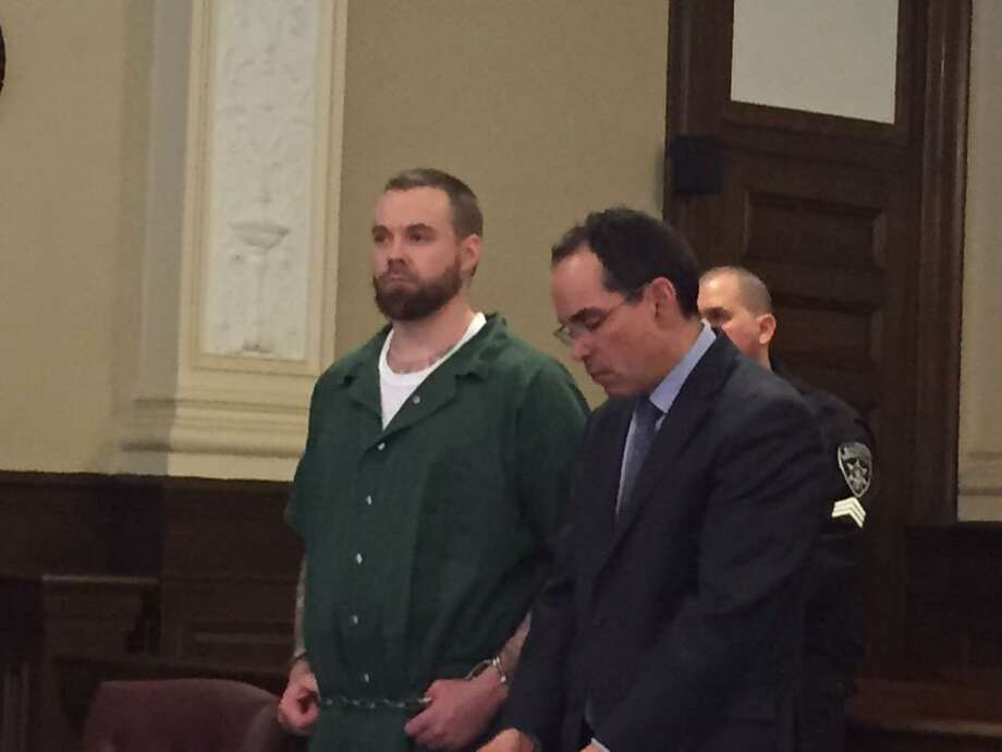 Daniel Reuter, 33, left, stands in court Tuesday to plead guilty to manslaughter in connection with the killing of Allen and Maria Lockrow last year in Lansingburgh. Reuter agreed to testify against his allegedly accomplice, Jacob Heimroth, 33, as part of a plea bargain deal that carries a sentence of 40 years in prison. (Kenneth C. Crowe / Times Union)