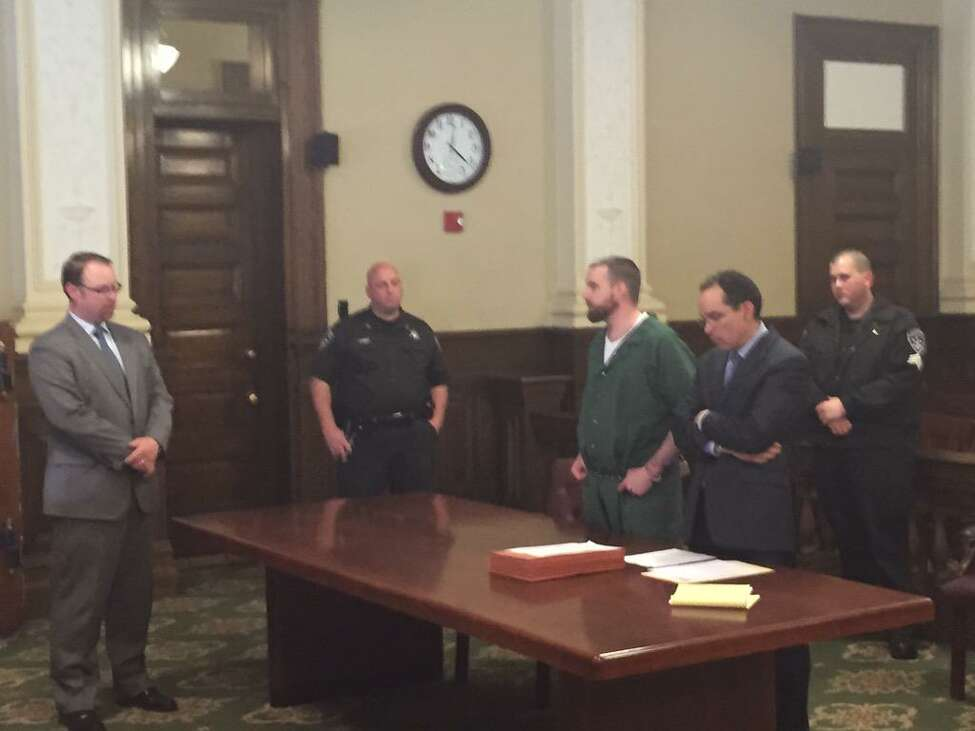 Daniel Reuter, 33, center, answers questions from Rensselaer County Assistant District Attorney Shane Hug as he pleaded guilty to manslaughter in connection with the killing of Allen and Maria Lockrow last year in Lansingburgh. Reuter agreed to testify against his allegedly accomplice, Jacob Heimroth, 33, as part of a plea bargain deal that carries a sentence of 40 years in prison. (Kenneth C. Crowe / Times Union)