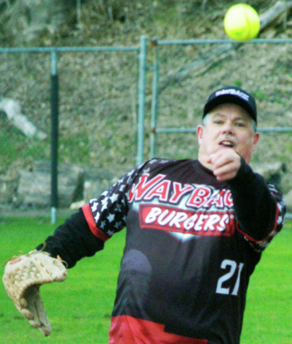 Veteran southpaw pitcher Bill Chemero of Wayback Burgers delivers the season's first pitch at Young's Field to open the 2015 New Milford Parks & Recreation adult softball season. April 23, 2015