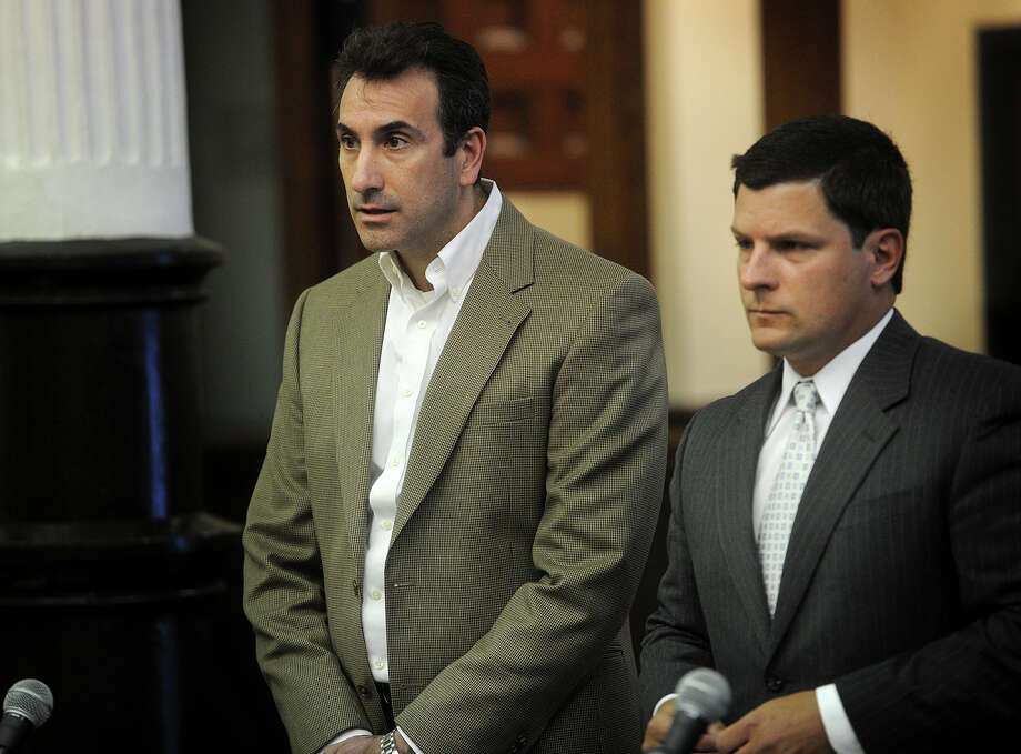 Standing with his lawyer Frank Riccio, right, Vincent Pizzolato, of Monroe, requests accelerated rehabilitation for the accidental shooting of his son during an appearance in Superior Court in Bridgeport, Conn. on Tuesday, April 28, 2015. Photo: Brian A. Pounds / Connecticut Post