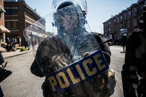 BALTIMORE, MD - APRIL 28:  A Maryland state trooper stands guard near a CVS pharmacy that was destroyed yesterday during rioting after the funeral of Freddie Gray, on April 28, 2015 in Baltimore, Maryland. Gray, 25, was arrested for possessing a switch blade knife April 12 outside the Gilmor Houses housing project on Baltimore's west side. According to his attorney, Gray died a week later in the hospital from a severe spinal cord injury he received while in police custody.  (Photo by Andrew Burton/Getty Images)