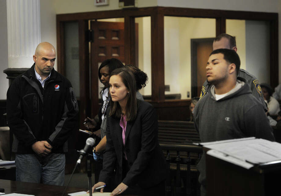 Joe Salgado, son of slain Bridgeport grocer Jose Salgado, stares down Treizy Lopez, of New Haven, during his arraignment for the murder in Superior Court in Bridgeport, Conn. on Tuesday, April 28, 2015. Salgado delivered a statement from the victim's family. Representing Lopez is Assistant Public Defender Kelly Berwick. Photo: Brian A. Pounds / Connecticut Post