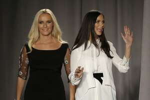Marchesa designers Georgina Chapman, right, and Keren Craig greet the crowd after showing their Spring 2014 collection during Fashion Week in New York, Wednesday, Sept. 11, 2013.