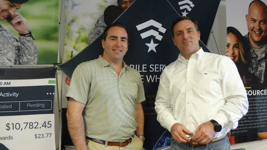 Andrew Reilly, left, and Brendan Reilly chose Stamford as the headquarters for their Defense Mobile, which offers wireless plans to U.S. military service members, veterans and their families. Photo: Alexander Soule / Stamford Advocate