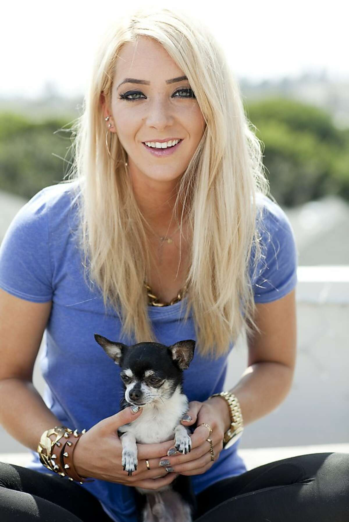 Jenna Marbles, whose real name is Jenna Mourey, with her namesake Chihuahua, Marbles, on the roof of her town house in Santa Monica, Calif., March 26th, 2013.