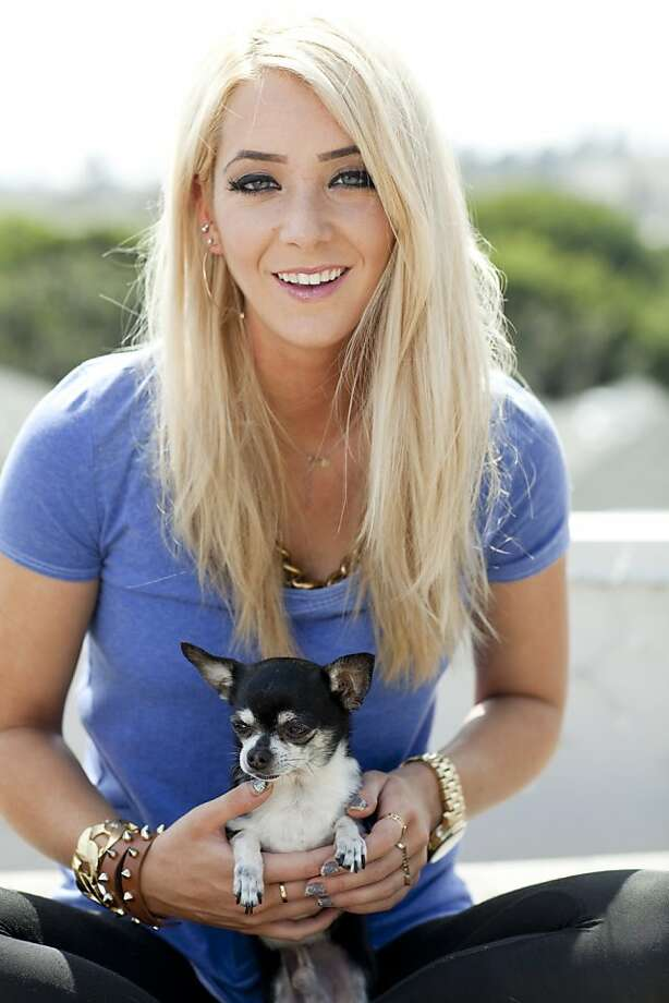 Jenna Marbles, whose real name is Jenna Mourey, with her namesake Chihuahua, Marbles, on the roof of her town house in Santa Monica, Calif., March 26th, 2013. Photo: Stephanie Diani, New York Times
