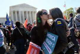 WASHINGTON, DC - APRIL 28:  Pro-gay rights protesters kiss outside the US Supreme Court on April 28, 2015 in Washington, DC. The Supreme Court meets to hear arguments whether same-sex couples have a constitutional right to wed in the United States, with a final decision expected in June. (Photo by Olivier Douliery/Getty Images)