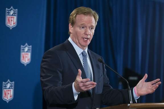 FILE - In this Oct. 8, 2014, file photo, NFL football commissioner Roger Goodell speaks during a news conference following a meeting of NFL owners and executives in New York. Two members of Congress have asked Goodell to clarify whether teams can lose draft picks if they do not properly address domestic violence. (AP Photo/John Minchillo, File)