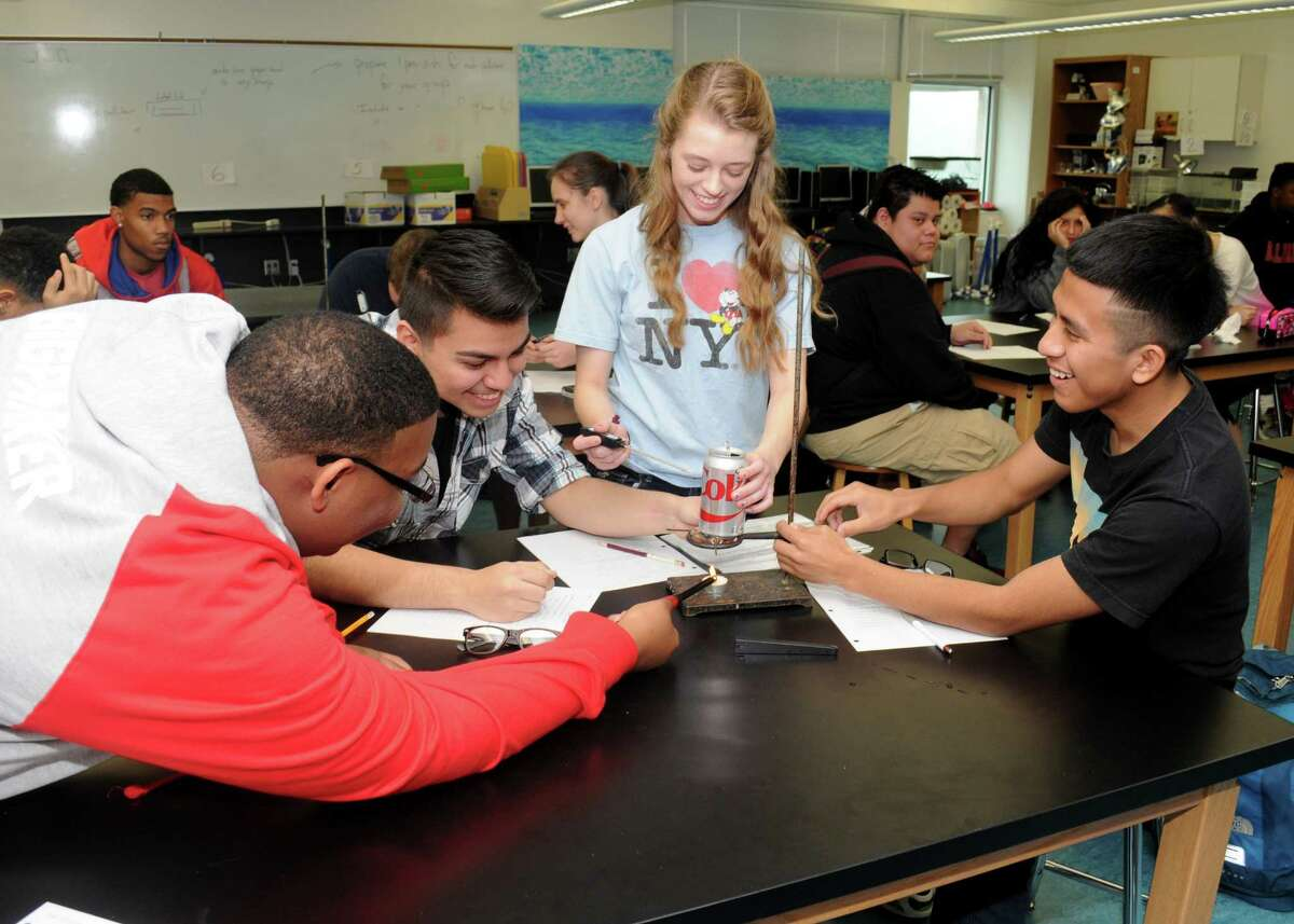 Working on a lab experiment are Bellaire High School 11th-grade students Kevin Parker, left, Jesus Sanchez, Hava Schultz and Santiago Sintillo.