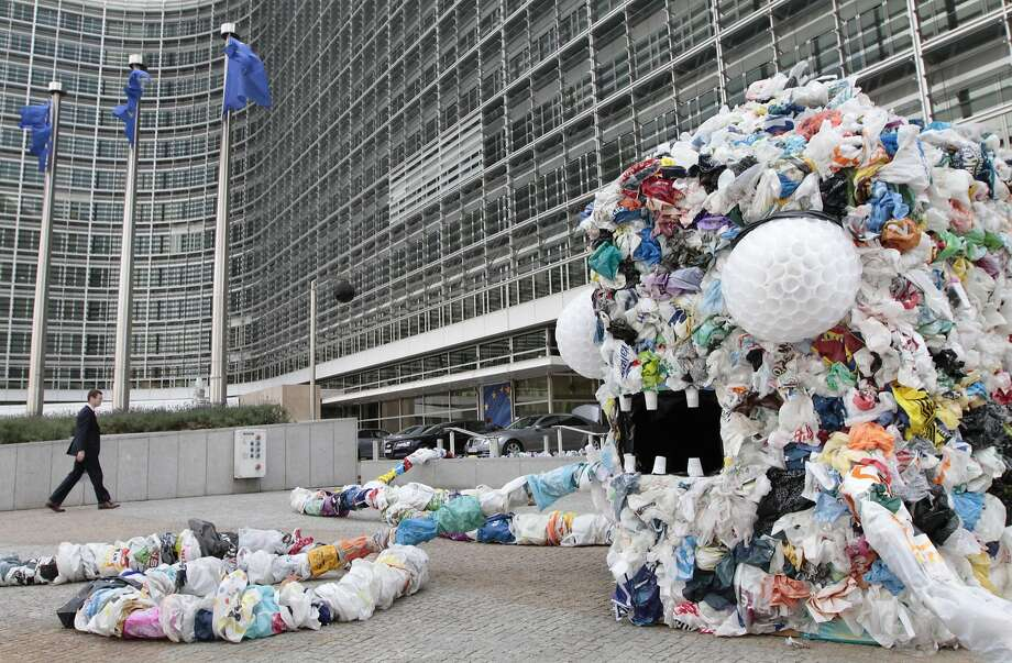 A sculpture made from plastic bags sits in front of European Union headquarters in Brussels in 2011. Photo: Yves Logghe, Associated Press