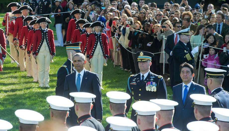 President Obama and Prime Minister Shinzo Abe review the Honor Guard during state arrival ceremonies at the White House. Photo: Paul J. Richards, AFP / Getty Images