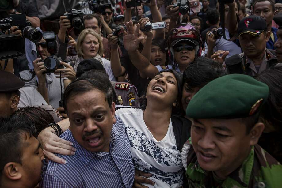 CILACAP, CENTRAL JAVA, INDONESIA - APRIL 28: Brintha Sukumaran (C), a sister of Australian death row prisoner Myuran Sukumaran's screams as she arrives at Wijaya Pura port to visit her brother at Nusakambangan prison ahead of the executions of the Bali 9 on April 28, 2015 in Cilacap, Central Java, Indonesia. Condemned Bali Nine duo Andrew Chan and Myuran Sukumaran have been given 72 hours execution notice. The execution could be held as soon as Tuesday midnight on Nusukamban Island where they have been held, awaiting there fate since March 4th, 2015. Chan and Sukumaran were both sentenced to death after being found guilty of attempting to smuggle 8.3kg of heroin valued at around $4 million from Indonesia to Australia along with 7 other accomplices. (Photo by Ulet Ifansasti/Getty Images) *** BESTPIX *** Photo: Ulet Ifansasti