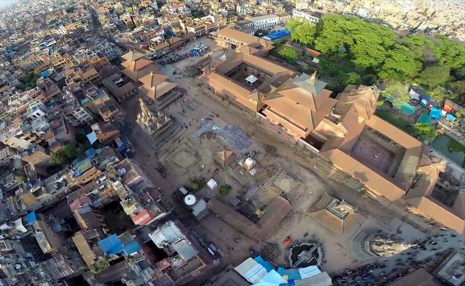 In this image made from drone video taken on Monday, April 27, 2015, an aerial view of damage caused by Saturday's earthquake in Patan Durbar Square, Kathmandu, Nepal. Helicopters crisscrossed the mountains above a remote district Tuesday, April 28, 2015 near the epicenter of the weekend earthquake in Nepal that killed more than 4,600 people, ferrying the injured and delivering emergency supplies. Officials said 250 villagers were feared missing in a new mudslide. Photo: Casey Allred, Associated Press