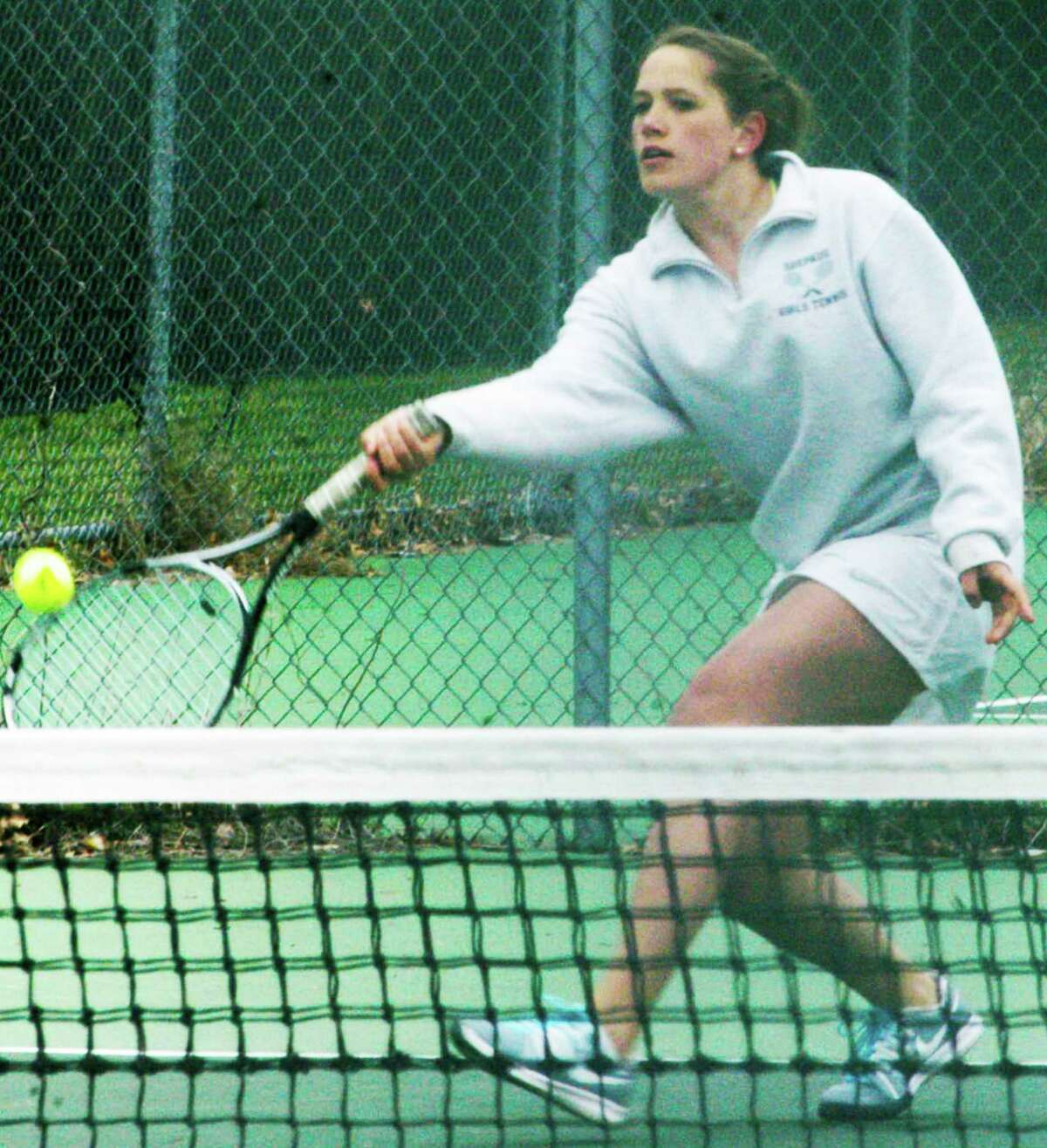 Spartan junior Haley Pesce demonstrates her touch with a finessed forehand during her singles victory as Shepaug Valley School girls' tennis whitewashes Lewis Mills, 7-0, April 24, 2015 on the Shepaug courts in Washington.