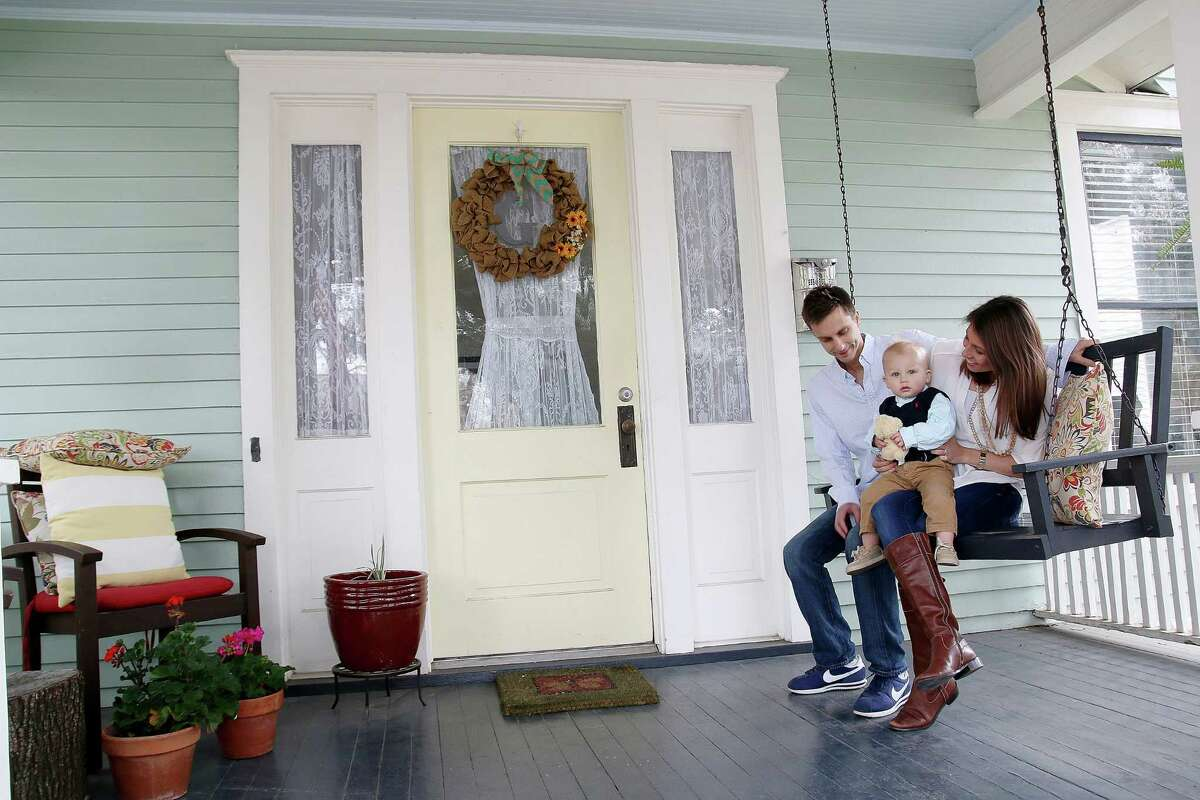 David and Andrea Gorney and their son Luke Wallace enjoy a cool morning on the front porch of their home on Bayland Avenue in Woodland Heights.