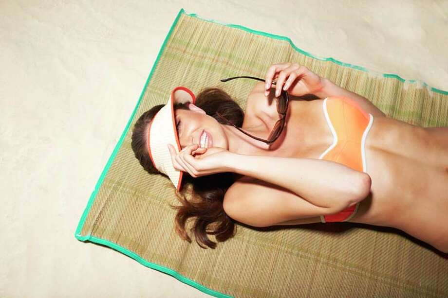 Tanning: Spending time in the sun feels good and people with this addiction enjoy the way they look with brown skin, but this addiction can cause skin cancer. Photo: Jonathan Storey, Getty Images / (c) Jonathan Storey