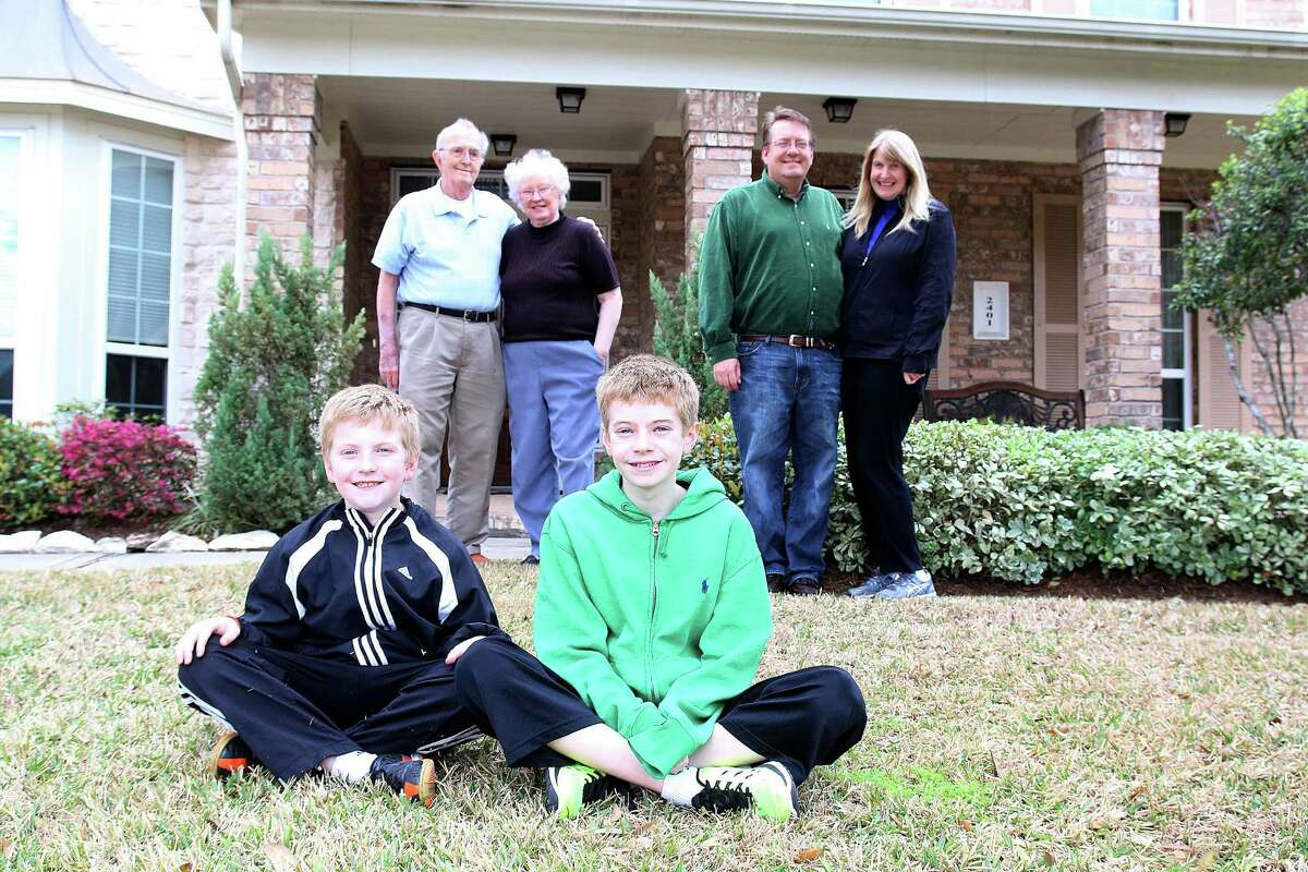 John and Sue Stewart, left, say they enjoy living in Shadow Creek Ranch close to their son and daughter-in-law Erik and Kristi and grandkids Sean, 9, and Ian, 12. The community attracts many homebuyers who are retired as well as professionals who work in the Texas Medical Center and downtown Houston.