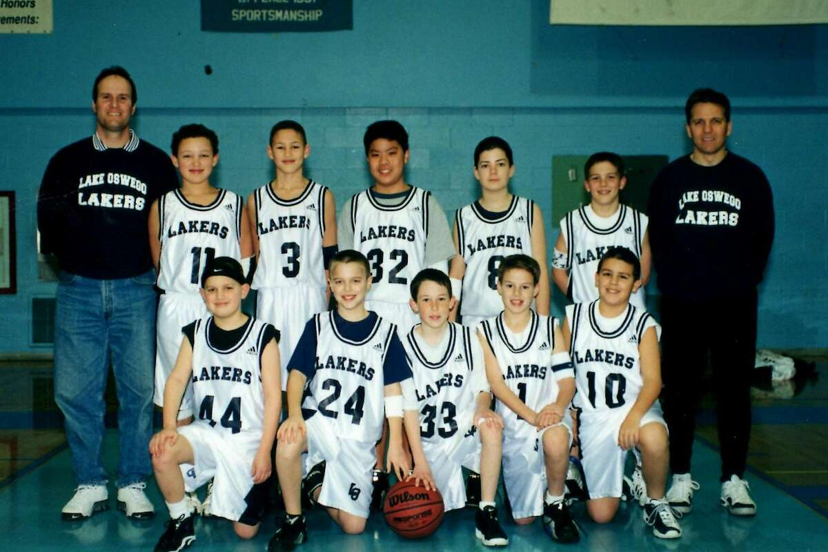Trayce Thompson (No. 11) and Klay Thompson (No. 3) pose with their youth basketball team, the Lake Oswego (Ore.) Lakers. Their father, Mychal, played for the Los Angeles Lakers in the late '80s and early '90s.