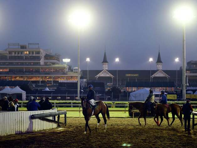 Lights illuminate the track at Churchill Downs early Tuesday morning, April 28, 2015, in Louisville, Ky. The 141st running of The Kentucky Derby starts Saturday.  (Skip Dickstein/Times Union) Photo: SKIP DICKSTEIN
