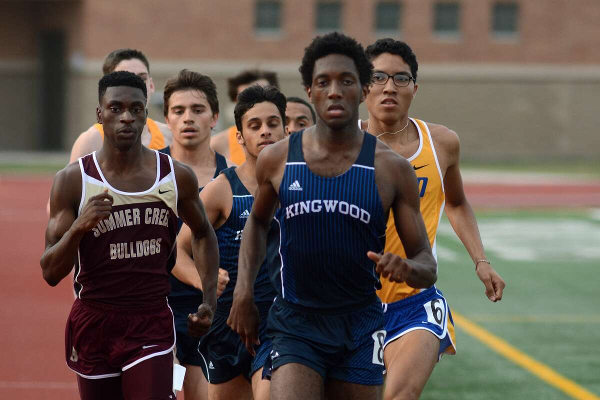 Kingwood's Myles Marshall, followed closely by Summer Creek's Cam White, left, amd Klein's Dominic Baptiste, right, led the pack in the boys 800-meter run at the District 15/16-6A Area Track Meet at Turner Stadium in Humble.