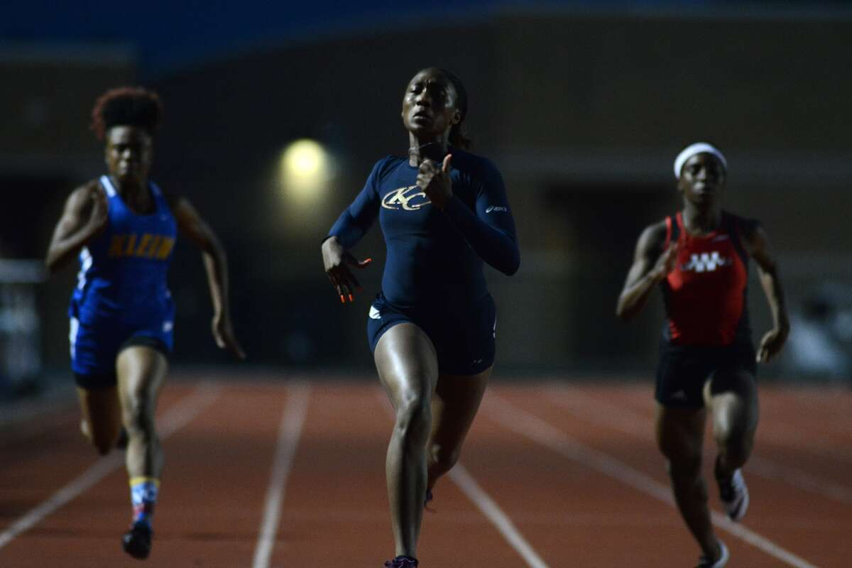 Klein Collins' Taylor Bennett, center, Klein's Imani Nave, left, and Westfield's Deja Keys, right, sprinted to a 1-2-3 finish in the girls 200-meter dash at the District 15/16-6A Area Track Meet at Turner Stadium in Humble.