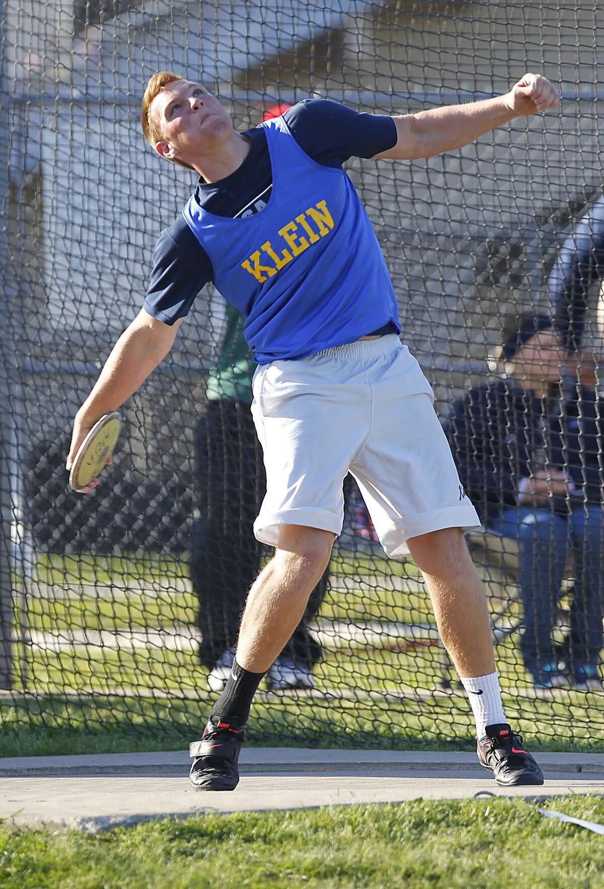 """Brody Gowing of Klein High School makes his first place winning discus throw of 167' 2"""" at the District 13/14 5A Area Track meet held at Klein Memorial Stadium on April 15, 2014."""