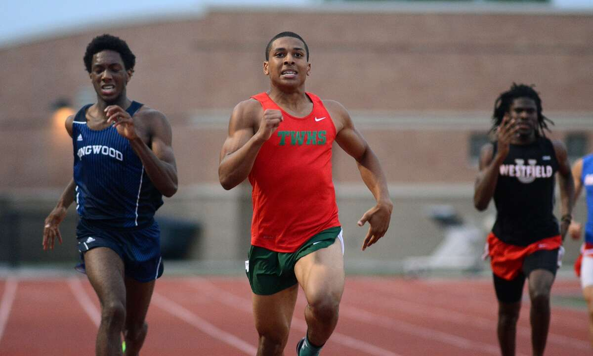 The Woodlands' Obi Igbokwe, center, pushes to the finish line ahead of Kingwood's Myles Marshall, left, as they finish 1-2 in the boys 400-meter dash at the District 15/16-6A Area Track Meet at Turner Stadium in Humble.