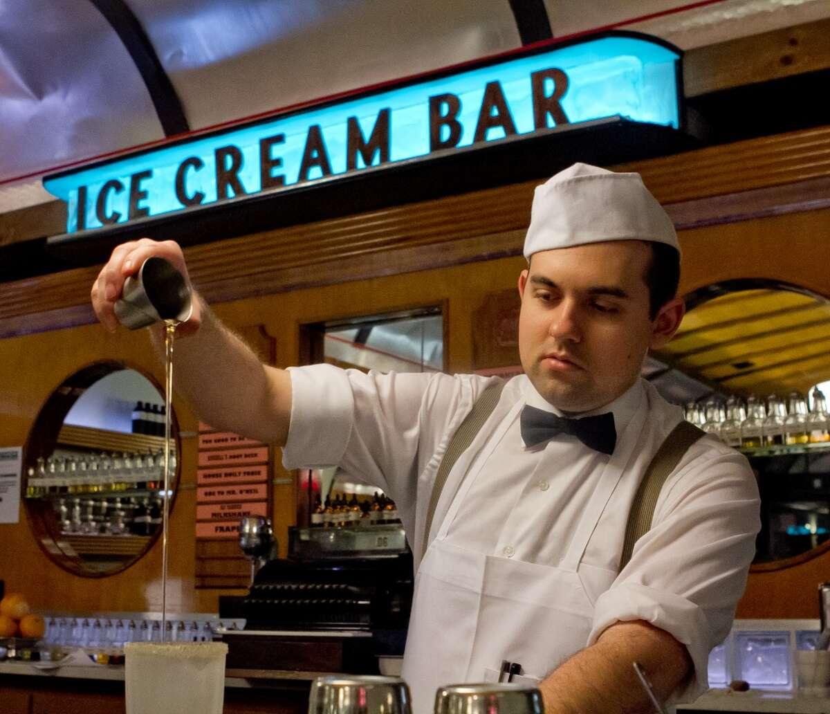 Christopher Simpson creates a soda at the Ice Cream Bar.