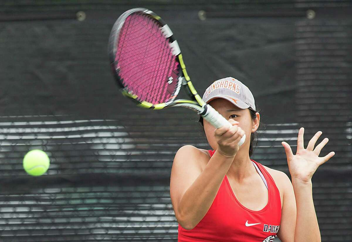 Dawson's Kelly Zhu hits a return shot against Langham Creek's David Mann and Kelsey Vincik in championship match of mixed doubles at the Class 6A Region III Tennis Tournament on Wednesday, April 22, 2015, in Deer Park. Mann and Vincik won the title 4-6, 6-4, 6-4. Zhu plays with her brother, Kevin Zhu. ( Brett Coomer / Houston Chronicle )