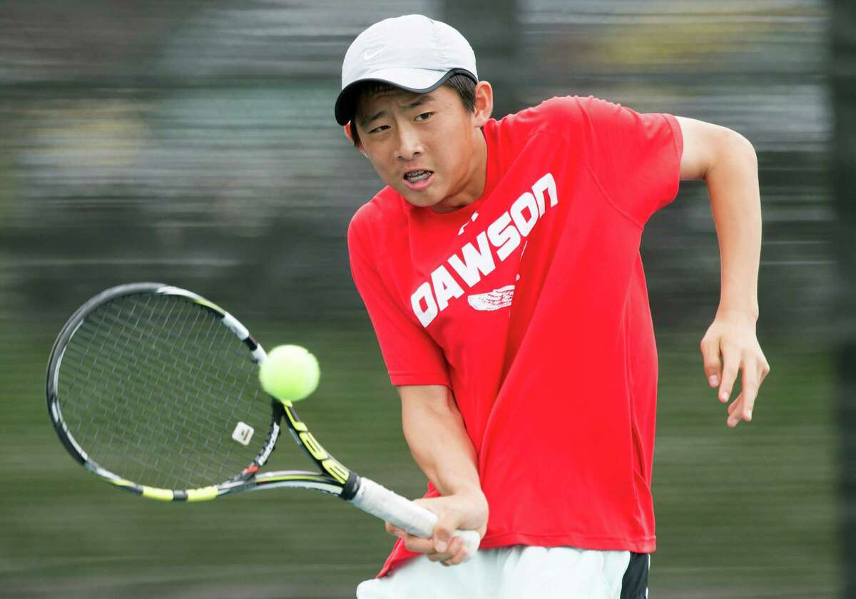 Dawson's Kevin Zhu hits a return shot against Langham Creek's David Mann and Kelsey Vincik in championship match of mixed doubles at the Class 6A Region III Tennis Tournament on Wednesday, April 22, 2015, in Deer Park. Mann and Vincik won the title 4-6, 6-4, 6-4. Zhu plays with his sister, Kelly Zhu. ( Brett Coomer / Houston Chronicle )