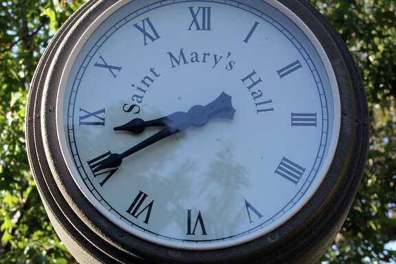 A clock that was given to the school in honor of the school's boarding students adorns a revamped area of the school's campus.