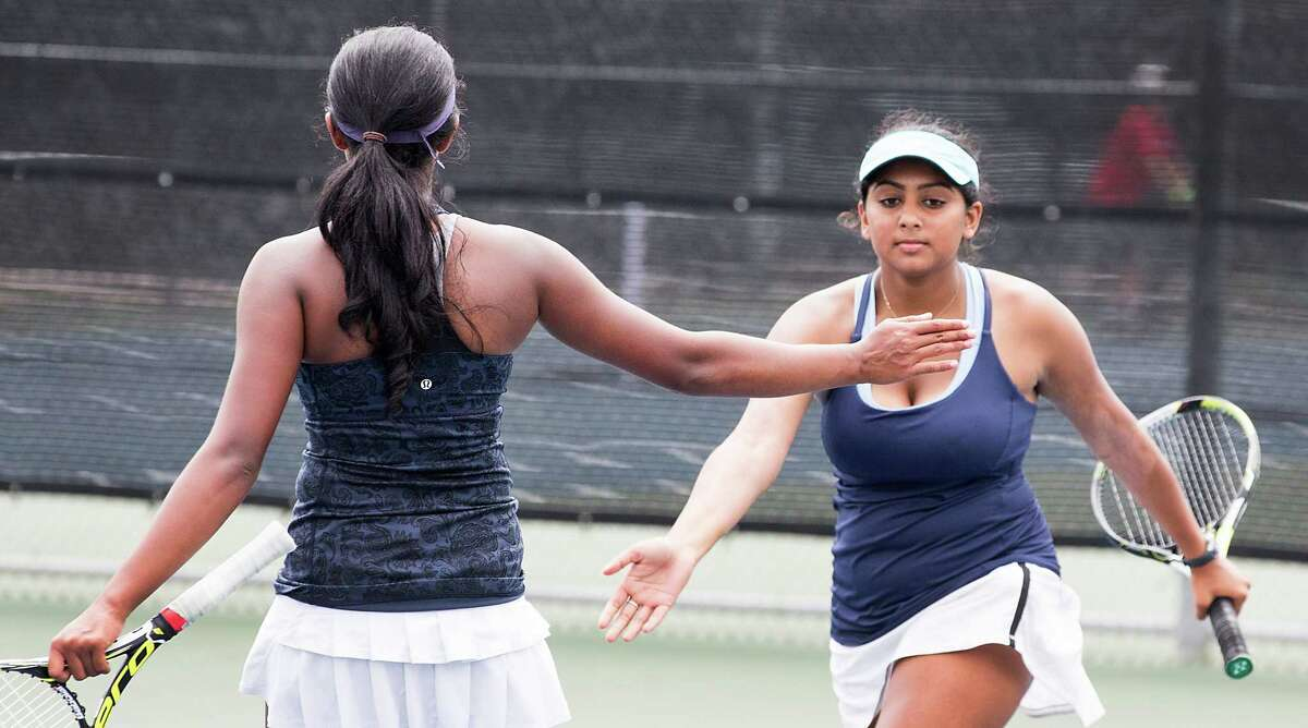 Clements' Sanjina Tripathy, right, and teammate Nikita Pradeep are one of two Rangers girls doubles teams to qualify for the state tournament at Texas A&M.