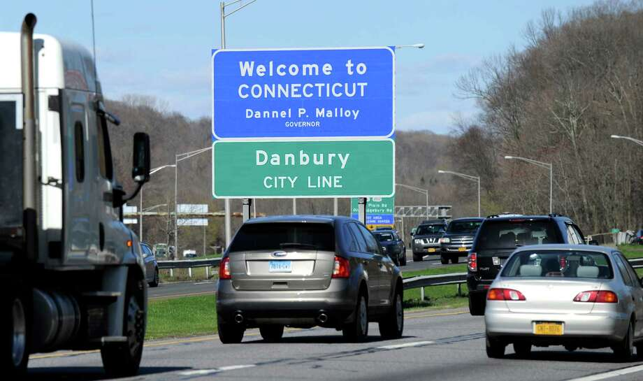 A welcome sign greets drivers as they cross the border from Brewster, N.Y., into Danbury, Connecticut, Tuesday, April 28, 2015. Photo: Carol Kaliff / The News-Times