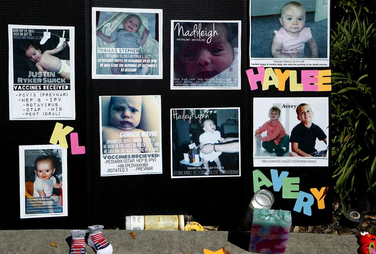 Pictures of children who died from vaccination complications are seen during a protest against SB277 before the Senate Judiciary Committee decision on the bill at the California State Capitol, Tuesday, April 28, 2015, in Sacramento, Calif. SB277 would eliminate the personal-belief exemption, the option California parents use to skip their child?•s school immunizations, but still allow children to be exempt for medical reasons.
