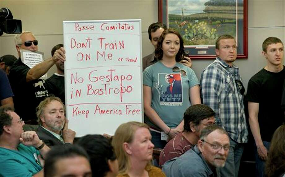 See some of the letters sent to Gov. Greg Abbott's office after his decision to request that the Texas Guard monitor a military training exercise in the state.Bob Welch, standing at left, and Jim Dillon, hold a sign at a public hearing about the Jade Helm 15 military training exercise in Bastrop, Texas, Monday April 27, 2015. (Jay Janner/Austin American-Statesman via AP) Photo: Jay Janner, Associated Press / Austin American-Statesman