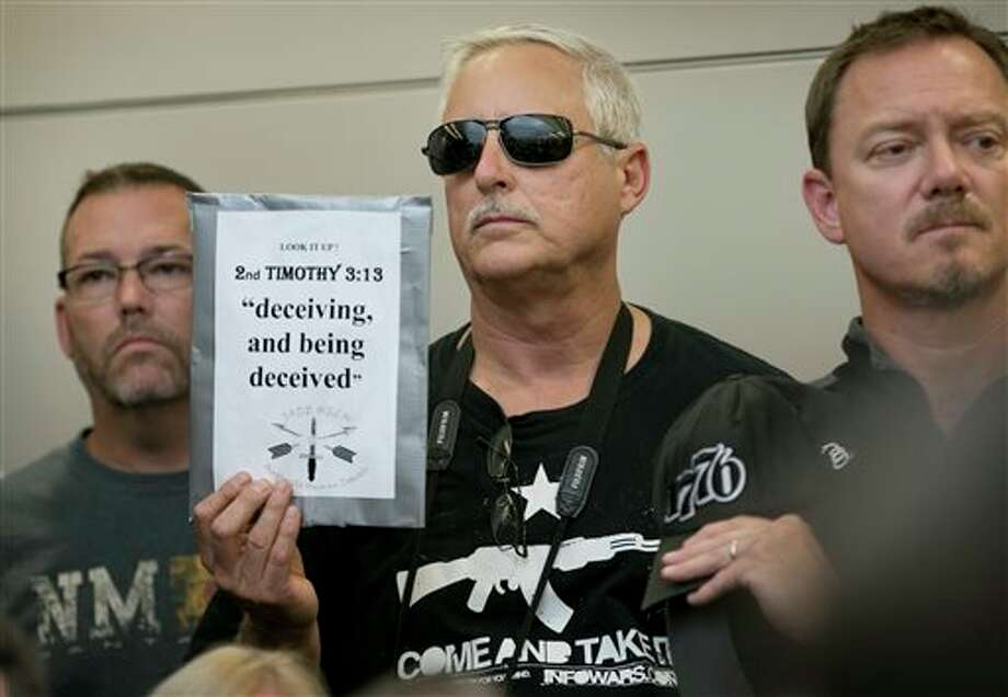 Bob Welch holds a sign at a public hearing about the Jade Helm 15 military training exercise in Bastrop, Texas, Monday April 27, 2015. (Jay Janner/Austin American-Statesman via AP)  AUSTIN CHRONICLE OUT, COMMUNITY IMPACT OUT, INTERNET AND TV MUST CREDIT PHOTOGRAPHER AND STATESMAN.COM, MAGS OUT Photo: Jay Janner, Associated Press / Austin American-Statesman