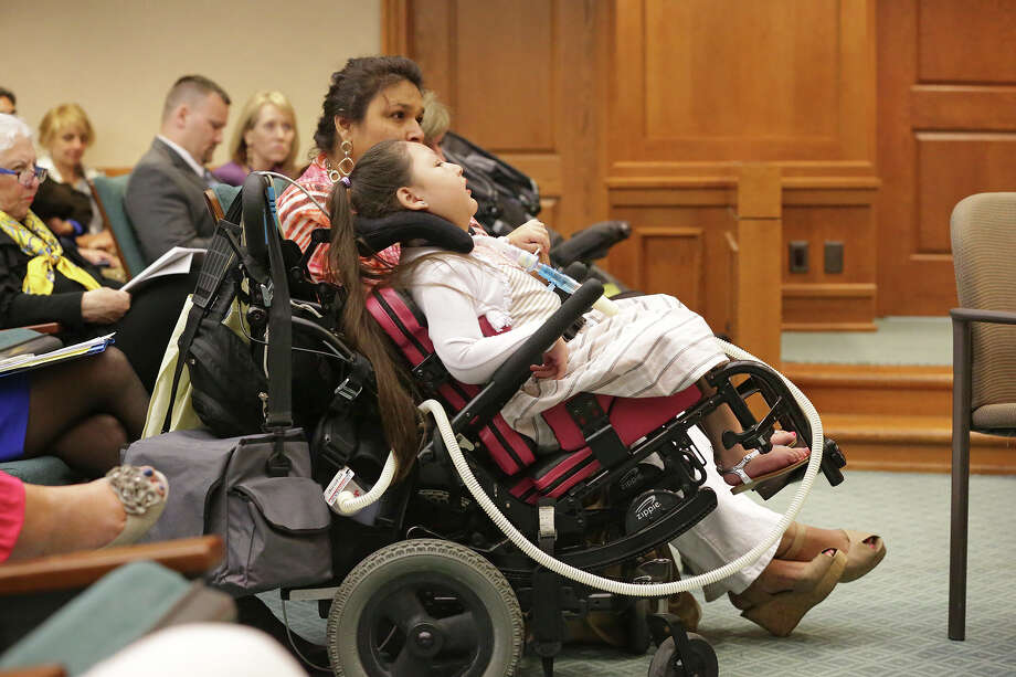 Victoria Ammann, of San Antonio, sat with her daughter, Emily, as families with children who suffer from uncontrolled seizures prepare to testify before the House of Representatives Committee on Public Health in Austin concerning the proposed legalization of CBD oil, which is derived from marijuana. Photo: Tom Reel /San Antonio Express-News