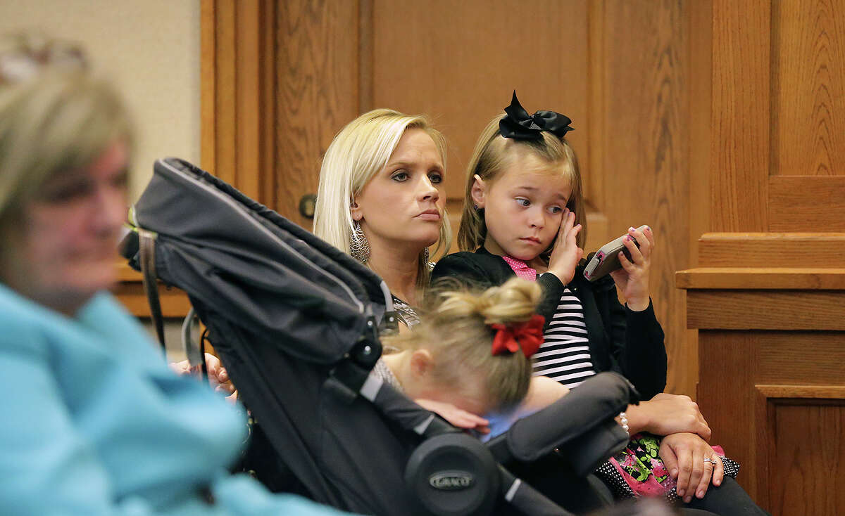 Shawna Davis waited with her two daughters, Karly, left, and Kendall as families listen to testimony Tuesday before the House of Representatives Committee on Public Health in Austin concerning legalization of CBD oil as a medicine for people with uncontrollable seizures.
