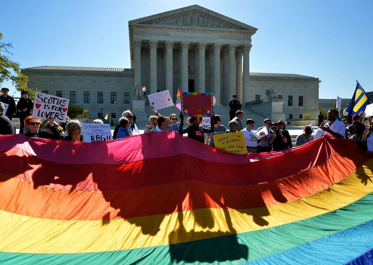 Supporters of same-sex marriages gather outside the US Supreme Court waiting for its decision on April 28, 2014 in Washington, DC. The US Supreme Court is hearing arguments on whether gay couples have a constitutional right to wed -- a potentially historic decision that could see same-sex marriage recognized nationwide. AFP PHOTO / MLADEN ANTONOVMLADEN ANTONOV/AFP/Getty Images