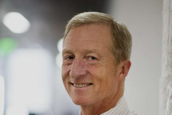 """Thomas """"Tom"""" Steyer, founder and former chief executive officer of Farallon Capital Management LLC, stands for a photograph in San Francisco, California, U.S., on Wednesday, Oct. 8, 2014. As rising seas threaten Florida, billionaire Thomas Steyer is floating an $8.6 million campaign to save the state, opening 21 offices, deploying more than 500 staffers and volunteers and sending out a rolling ark. Photographer: David Paul Morris/Bloomberg *** Local Caption *** Tom Steyer"""