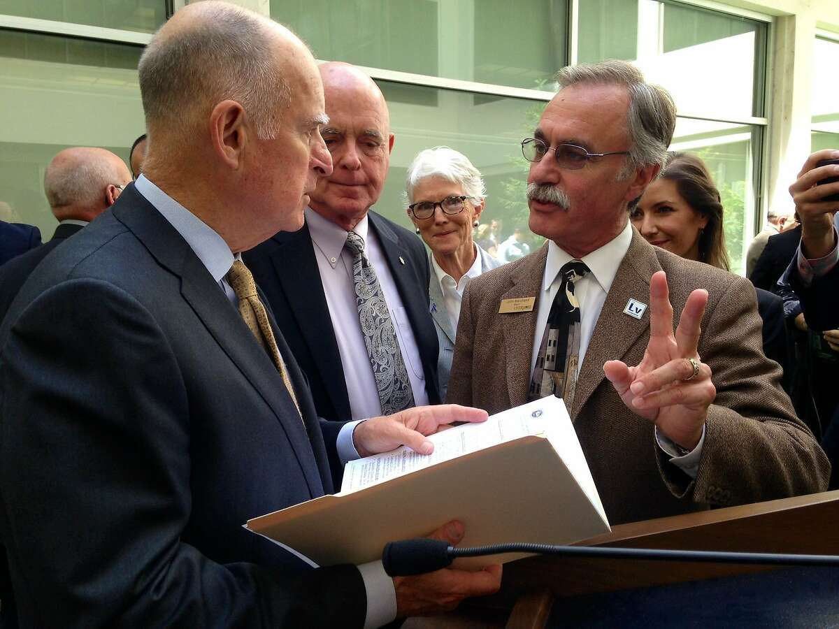 Gov. Jerry Brown talks with Livermore Mayor John Marchand on April 28, 2015 about Livermore's 30 percent water reduction, achieved since 2013. Brown met with mayors at the Capitol to discuss water reduction enforcement actions.