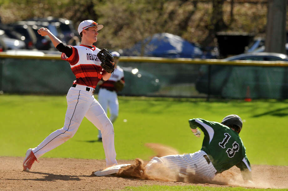 New Canaan second baseman Matthew Burger forces out Norwalk's Ryan Searles at second base during their baseball game at Mead Park in New Canaan, Conn., on Tuesday, April 28, 2015. New Canaan won, 2-1. Photo: Jason Rearick / Stamford Advocate