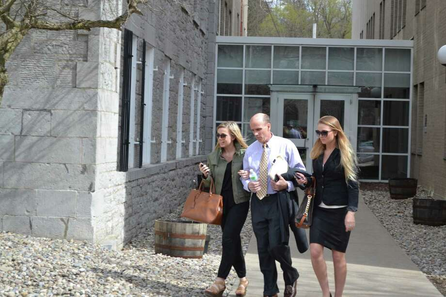 Cal Harris walks out of Schoharie County Court Tuesday, April 28, 2015, with his daughters Jenna and Cayla. The Tioga County man is accused of murdering his wife, Michele, on Sept. 11, 2001. Juries have twice convicted Harris of the murder, but both verdicts were reversed. (Keshia Clukey/ Times Union)