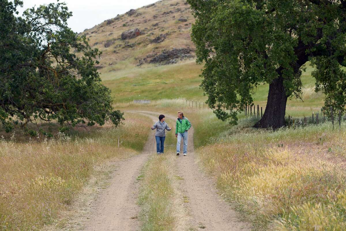 Andrea Mackenzie of the Santa Clara Open Space Authority and Doug McConnell walk through Coyote Valley Park on Thursday, April 23, 2015 in Morgan Hill, Calif. McConnell is filming a new series about open space in the Bay Area.