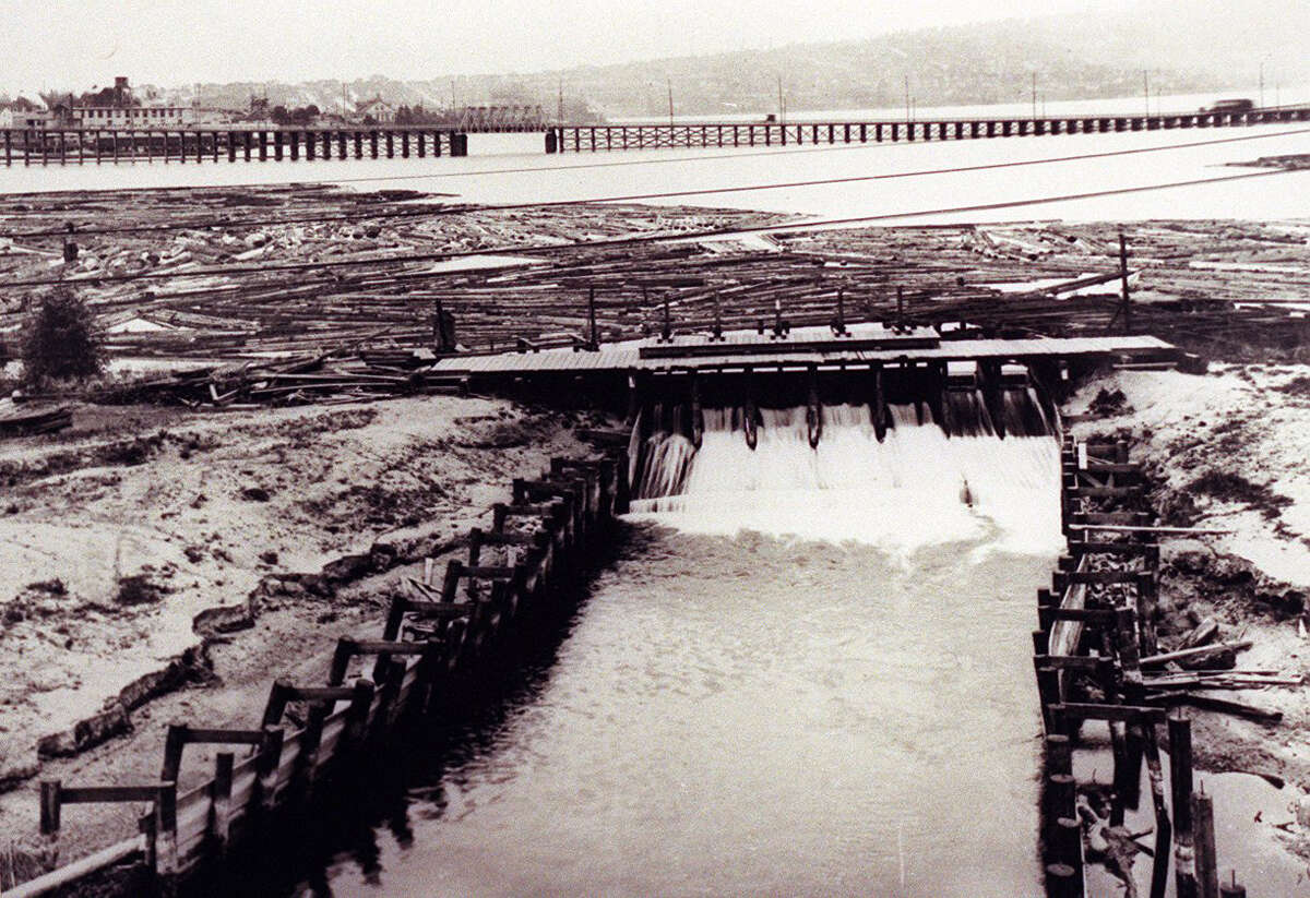 Fremont Dam and Stone Way Bridge, pictured in 1911. Photo credited to History House when published in the Seattle Post-Intelligencer.