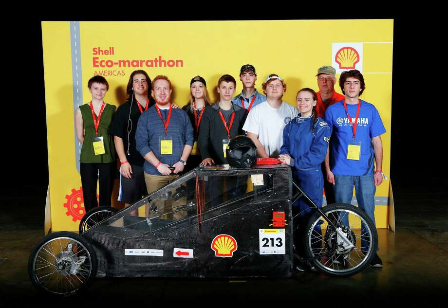 The Darien High School Fuel Cell Team poses next to their electric battery Prototype Car at the recent Shell Eco-Marathon Americas 2015 in Detroit, MI. Eight members of the team traveled to the competition with their faculty supervisor, Richard Reynolds. Photo: Rick Osentoski/AP Images For She, AP Images For Shell / AP2015