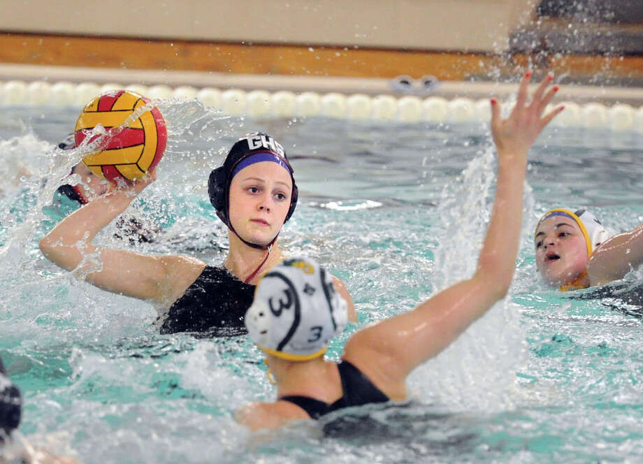 At left, Porter Carlson of Greenwich High School prepares to shoot as Borden Wahl (#3) of Greenwich Academy defends during the girls high school water polo match between Greenwich High School and Greenwich Academy at the Greenwich High School pool, Tuesday afternoon, April 28, 2015. Photo: Bob Luckey / Greenwich Time