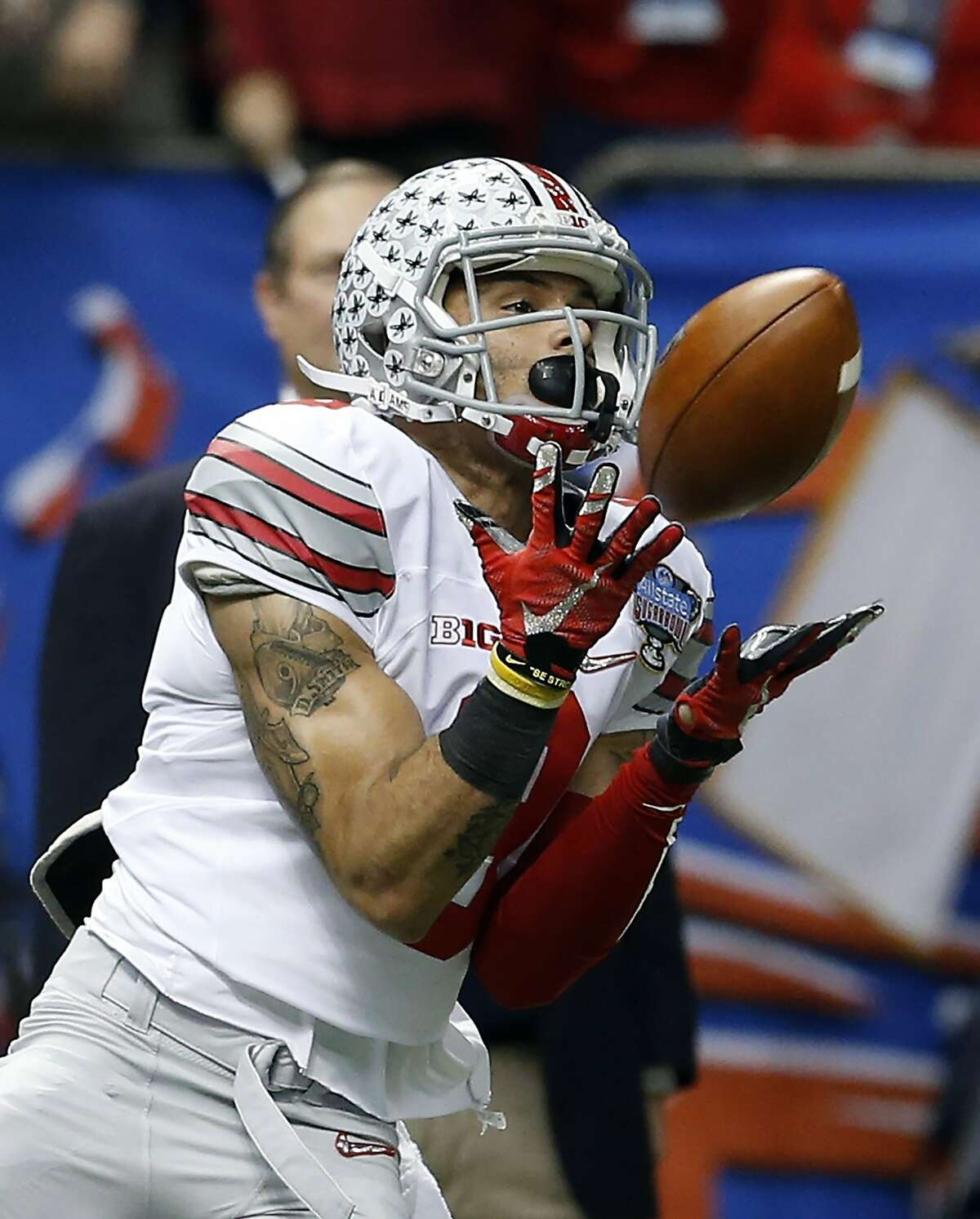 Ohio State wide receiver Devin Smith (9) catches a pass for a touchdown in the second half of an NCAA college football game against Alabama Thursday, Jan. 1, 2015, in New Orleans, La. (AP Photo/Butch Dill)
