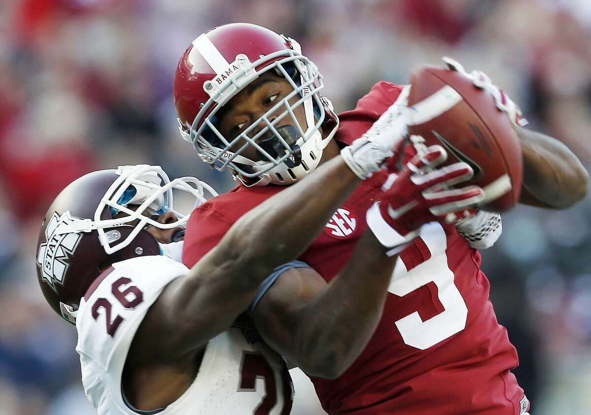 FILE - In this Nov. 15, 2014, file photo, Alabama wide receiver Amari Cooper (9) catches a 50-yard pass against Mississippi State defensive back Kendrick Market (26) in the first half of an NCAA college football game in Tuscaloosa, Ala. There will be several noticeable absences when the three-day draft starts Thursday night, including potential top picks. Florida State quarterback Jameis Winston, Oregon quarterback Marcus Mariota and Cooper all plan to skip the spotlight. (AP Photo/Butch Dill, File)